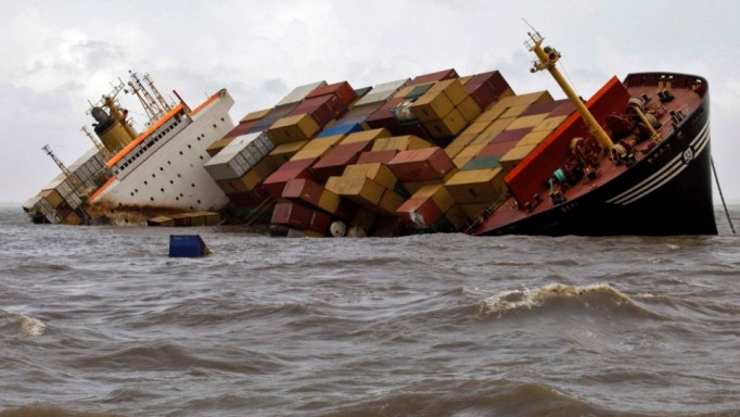 Containers fall from the deck of damaged cargo ship MSC Chitra in the Arabian Sea off the Mumbai coast